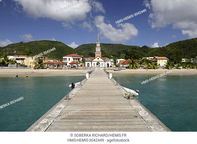 France, Martinique (French West Indies), Les Anses d'Arlet, pontoon and boat and view on the church and the village of Anse d'Arlet