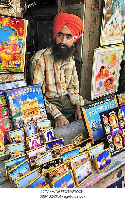 Sikh man sell holly pictures from Amritsar
