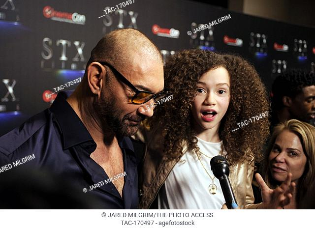 "Actors Chloe Coleman and Dave Bautista arrives at the STXfilms presentation red carpet for CinemaCon's """"The State Of The Industry: Past"