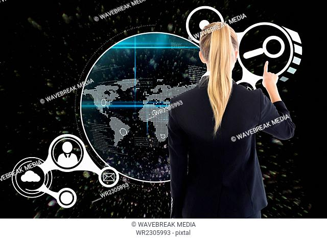 Businesswoman pointing at interface