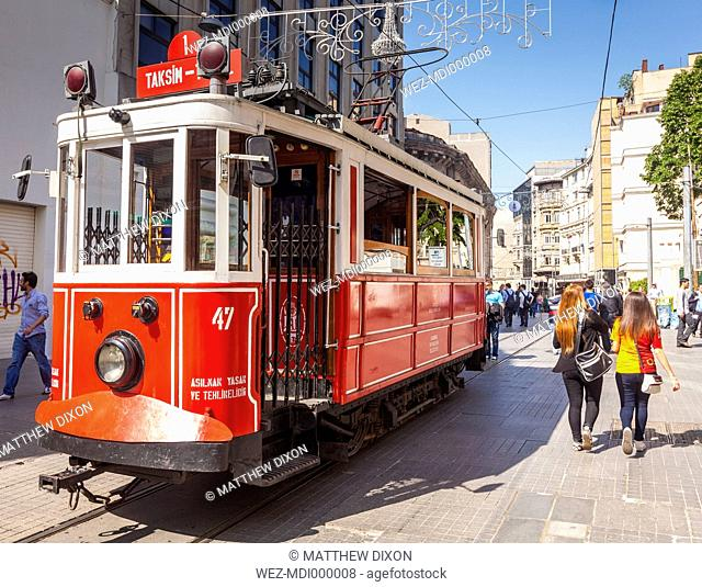 Turkey, Istanbul, Beyoglu, tourists and historical tram on Istiklal Avenue
