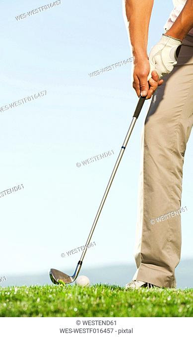 Italy, Kastelruth, Mid adult man playing golf on golf course