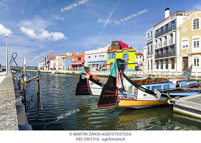 Traditional Moliceiro Boats, Cais dos Botiroes. Aveiro in Portugal on the coast of the Atlantic. Because of the many channels Aveiro is called the venice of...