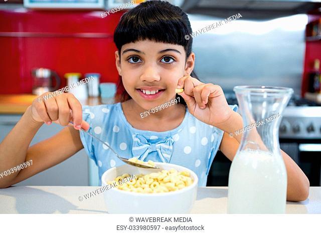 Portrait of smiling girl eating healthy breakfast