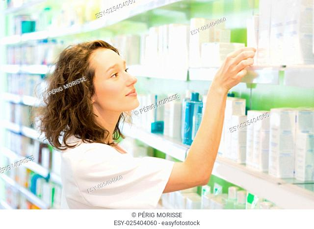 VIew of an Attractive pharmacist clean the store up