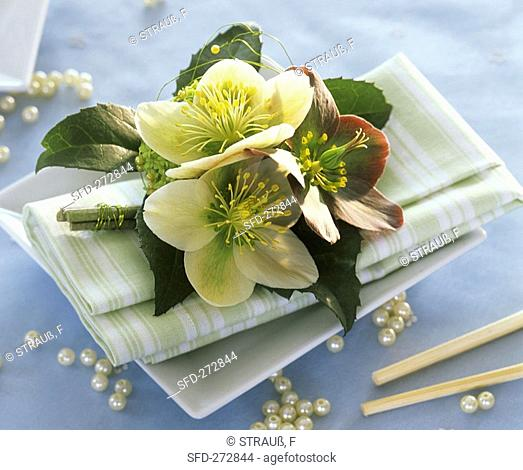 Napkin decorated with Christmas and Lenten roses