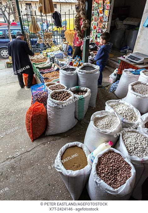 Pulses and nuts on display at a market in Saranda, Southern Albania