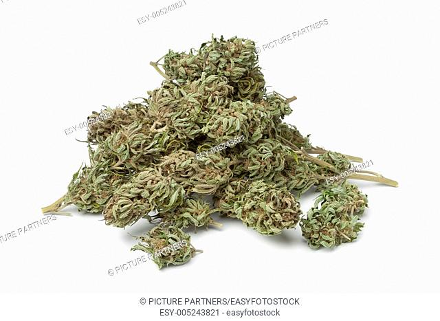Dried marijuana buds with visible THC on white background