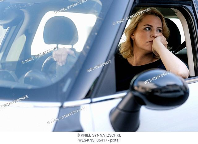 Bored woman looking out of car window