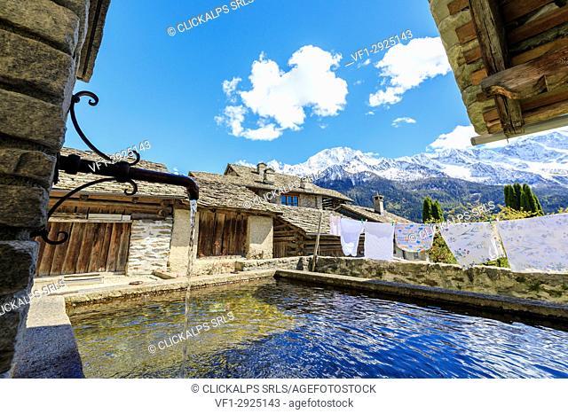 Typical fountain in the alpine village of Soglio Maloja canton of Graubunden Engadin Bregaglia Valley Switzerland Europe
