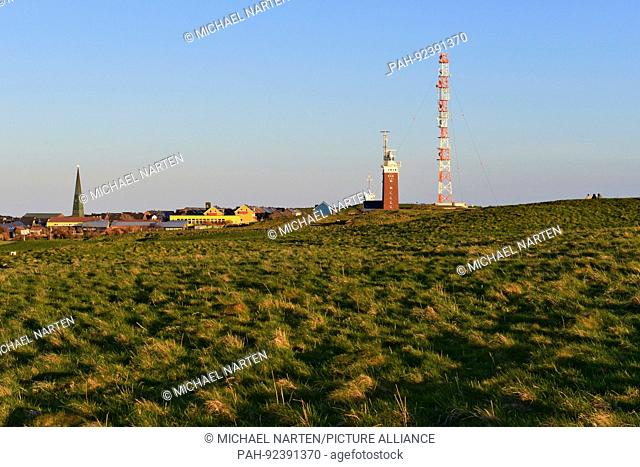 Heligoland's green highlands with buildings and houses from the settlement and the lighthouse beside the transmission mast, 2 May 2015 | usage worldwide