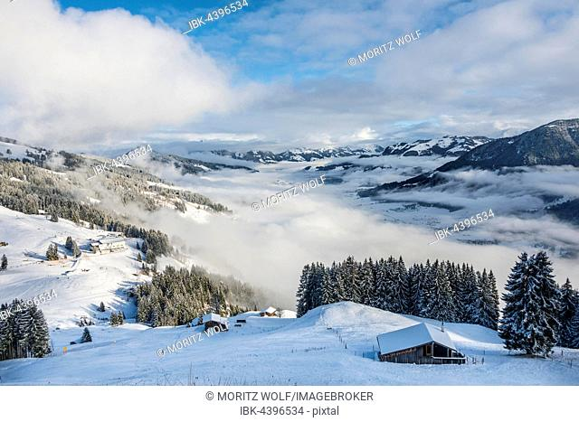 View of Alps and cloud cover over Inn Valley, ski resort, Brixen im Thale, Tyrol, Austria