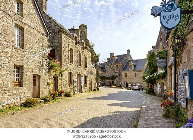 LOCRONAN, BRITTANY, FRANCE: View of a street in Locronan, one of the most beautiful villages in French Brittany, where unknown tourists stroll
