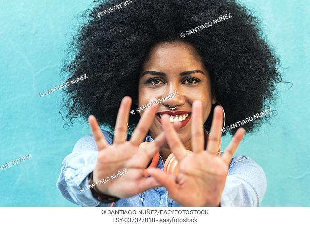 Portrait of beautiful happy afro american woman in the street