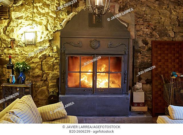 Wood burning fireplace home. Gipuzkoa. Basque Country. Spain