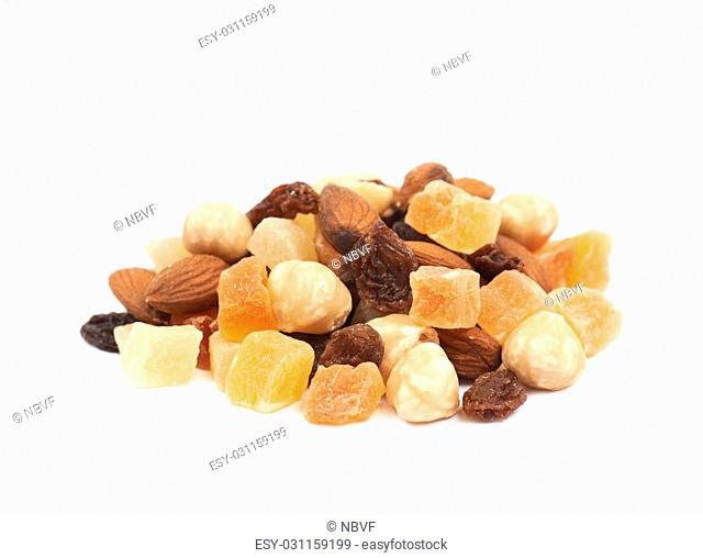 Pile of mixed nuts and dried fruits isolated over the white background