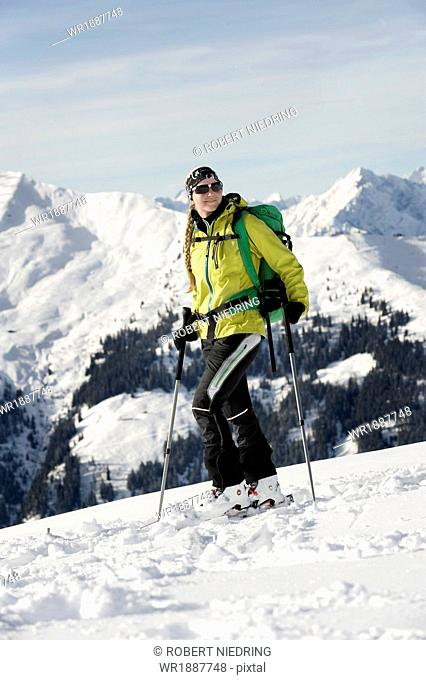 Female backcountry skier, mountain range in background, Alpbachtal, Tyrol, Austria, Europe
