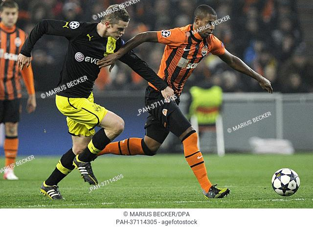 Dortmund's Sven Bender (L) and Fernandinho of Shakhtar Donetsk vie for the ball during the UEFA Champions League round of 16 first leg soccer match between...