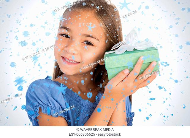 Smiling girl excited while holding a present