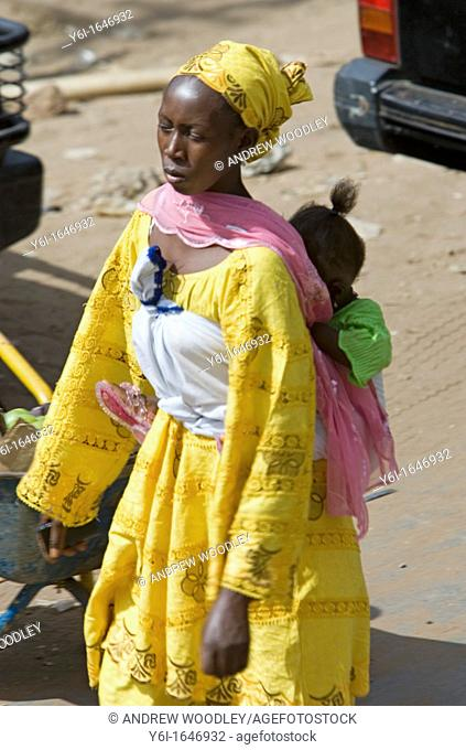 African woman carrying baby on back Stock Photos and Images