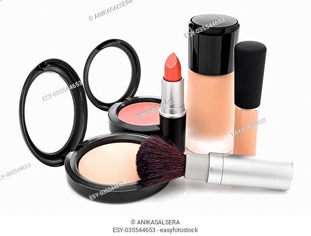 Makeup for natural look. Foundation, concealer, face powder, blush, lipstick, brush