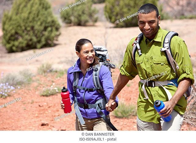 Couple holding hands out hiking, Sedona, Arizona, USA