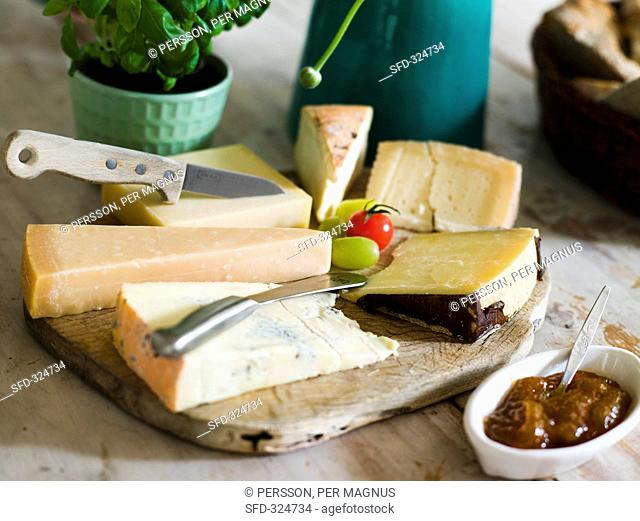 A mixed cheese platter with fig jam