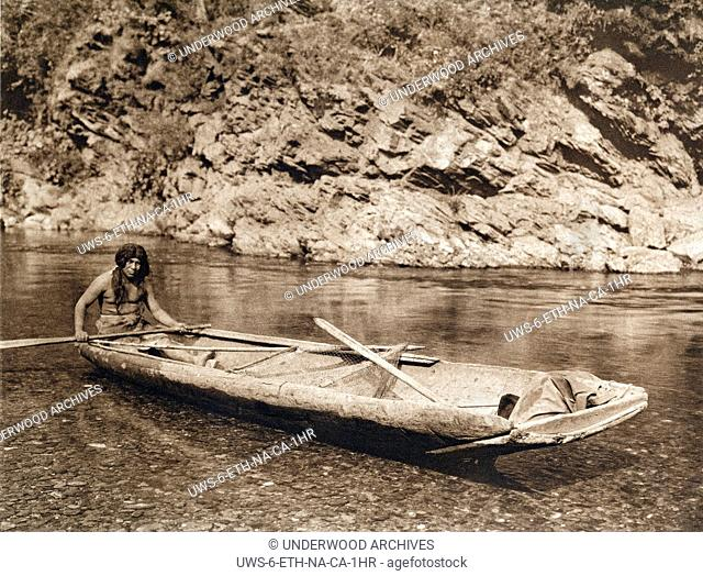Trinity River, California : 1923.A photogravure of a Yurok in his canoe on the Trinity River
