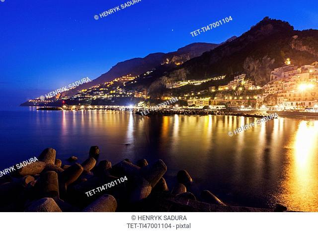 Illuminated town on coastline