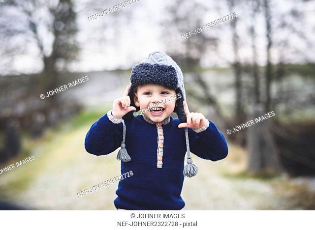Small boy wearing fur hat