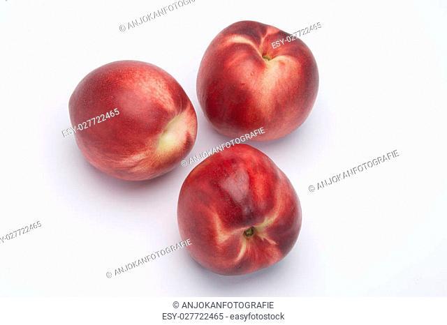 Delicious fresh nectarine fruit isolated on white background cutout