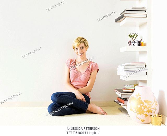 Smiling woman at home, studio shot