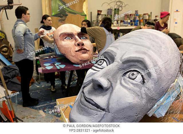 Seattle, Washington: Masks for Helen Keller (foreground) and Marie Curie at the Womxn's March Art Build at Urban ArtWorks