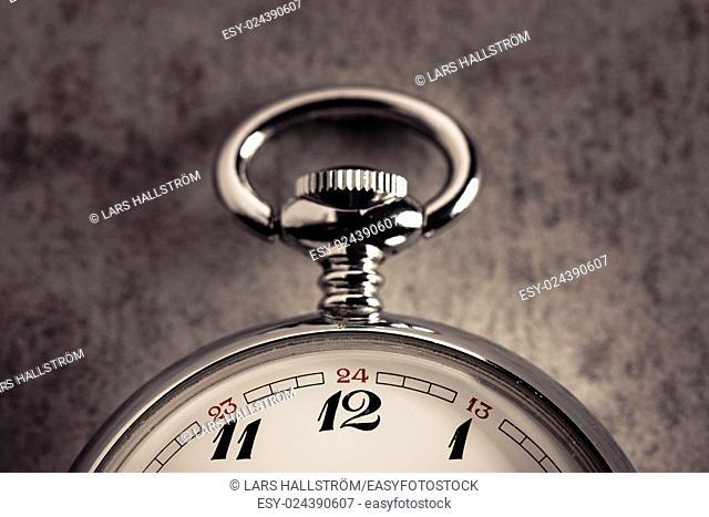 Old pocket watch detail. Symbol of time, deadline and nostalgia
