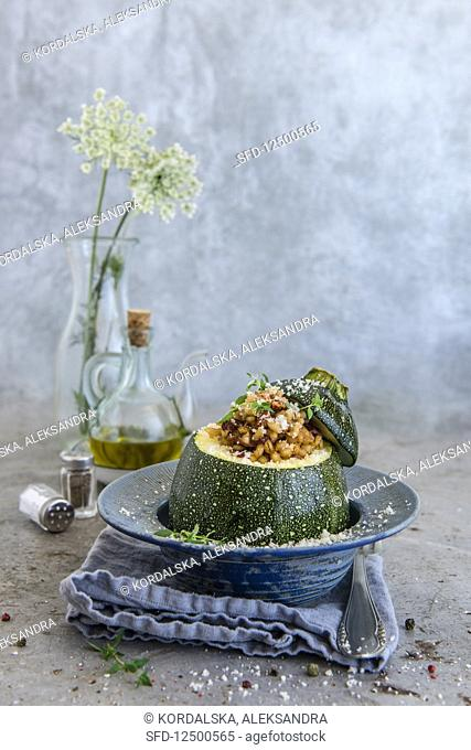 Round courgette filled with barley and dried tomatoes