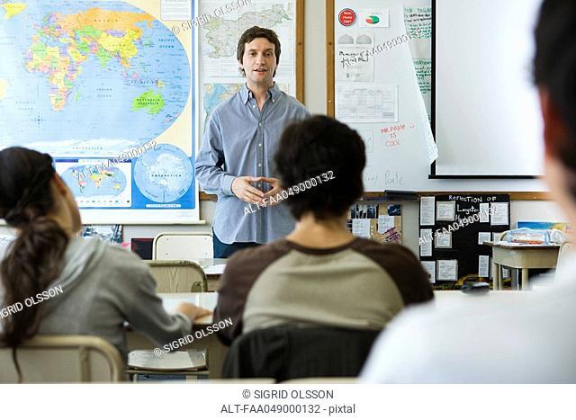 Teacher addressing high school class