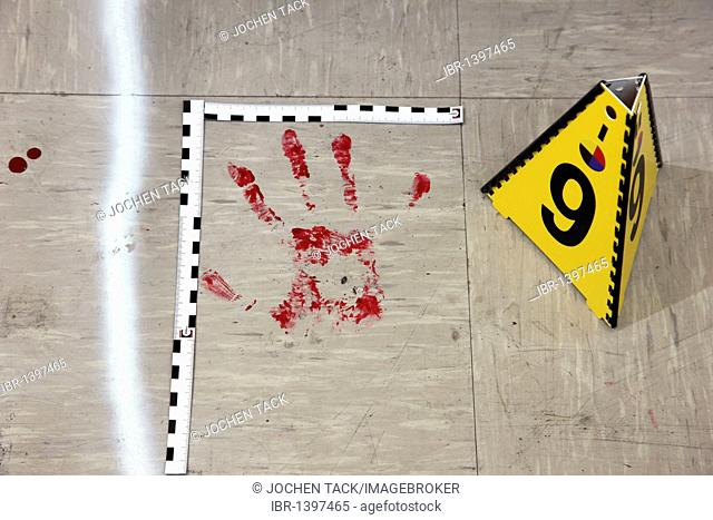 Securing of forensic evidence at a crime scene, after a capital offence, homicide, by the C.I.D., the Criminal Investigation Department, re-enacted scene