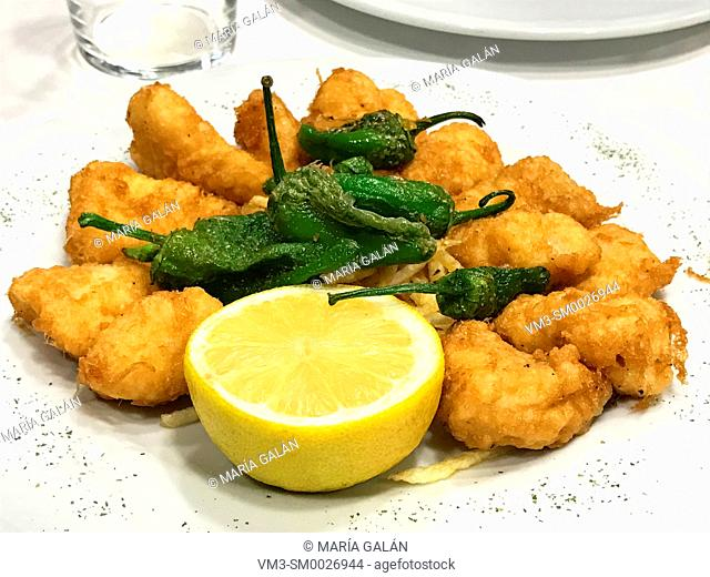 Fried monkfish with green peppers. Asturias, Spain