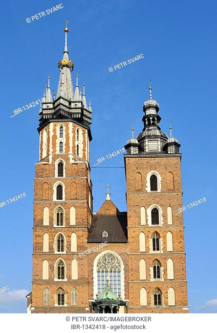 Close-up of towers of St. Mary's Basilica, Kosciol Mariacki, 14th century Gothic brick church, Main Market Square, Rynek Glowny, in Krakow, Cracow, Poland