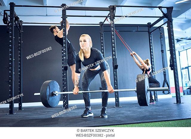 People exercising at gym