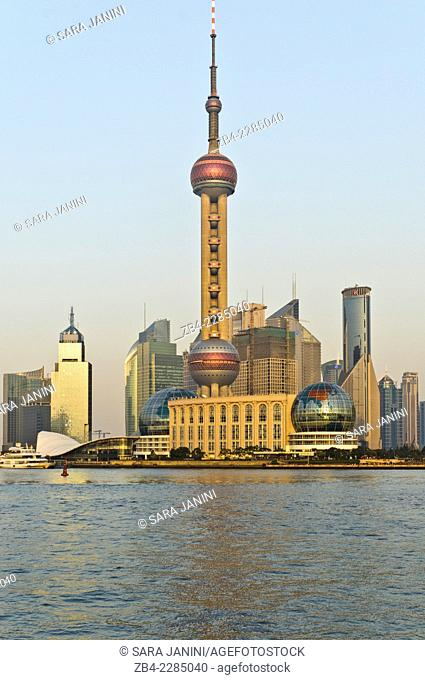 View of the 'Oriental Pearl TV Tower', Pudong Business District Skyline from the 'Bund' or 'Wai Tan' and Huangpu River, Shanghai, China, Asia