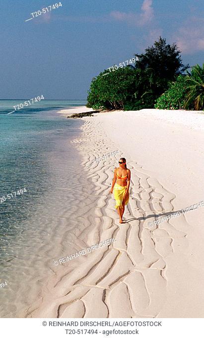 Woman walks on the beach, Maldives Island, Indian Ocean, Ari Atoll, White Sands Resort