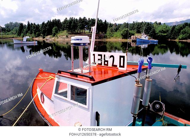 Cape Breton, Nova Scotia, NS, Canada, Red and blue lobster boats in Dingwall in Cape Breton