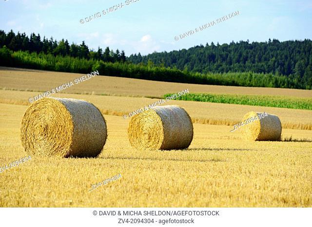 Hay bales lying on a cornfield, Germany