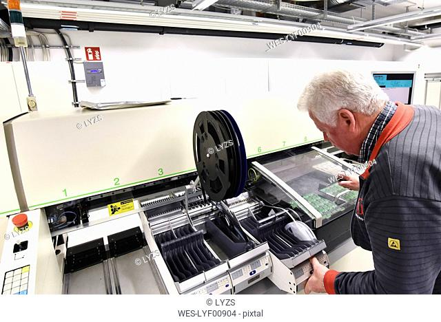 Man working on the manufacturing of circuit boards for the electronics industry
