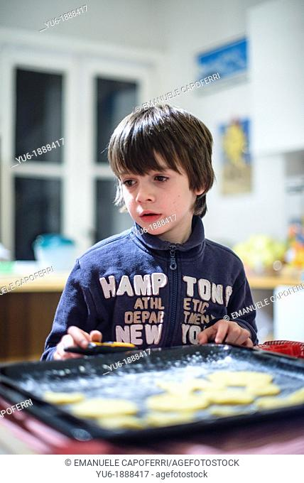 Children preparing cookies in the kitchen