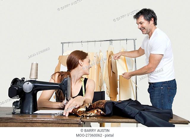 Designer and coworker working in design studio