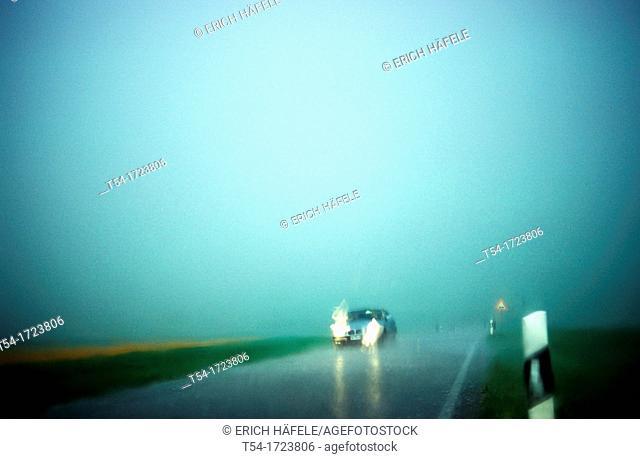 Car on a highway in heavy rain