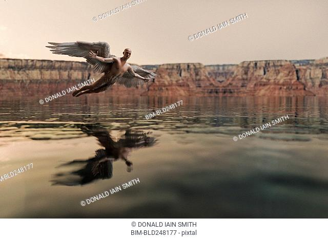 Angel flying over water