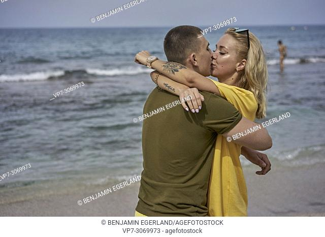 Young couple kissing on the beach, Russian ethnicity, Hersonissos, Crete, Greece